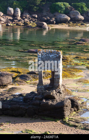 Village of Plouhmanac'h, France. Picturesque view of the Saint Guirec oratory on Ploumanac'h's Plage Saint-Guirec. - Stock Photo