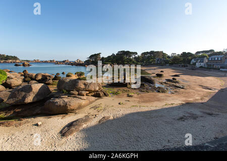 Village of Plouhmanac'h, France. Picturesque view of Ploumanac'h's Plage Saint-Guirec, with the Saint Guirec oratory in the centre of the image. - Stock Photo