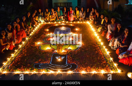 Assam, India. October 27, 2019. Students of Cotton University decorating Rangoli with Diyas (earthern lamps) on the occasion of Diwali festival in Guwahati on Sunday. Photo: David Talukdar/ Alamy Live News - Stock Photo