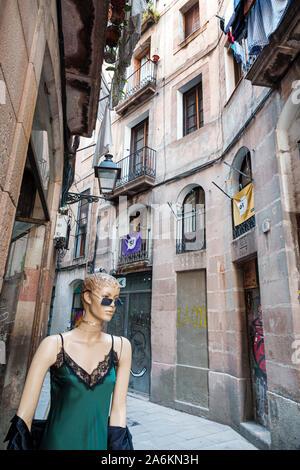 Barcelona Spain Catalonia Catalunya El Born historic district Ciutat Vella narrow street alley buildings mannequin Spanish Europe EU Eurozone - Stock Photo