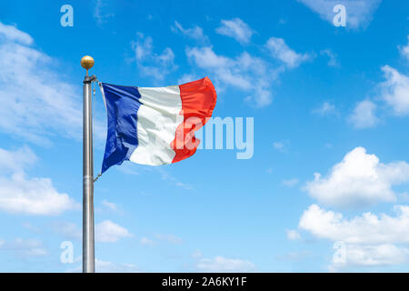 French flag against a blue sky background