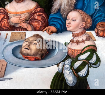 Salome with the head of John the Baptist, detail from a painting entitled the Feast of Herod by Lucas Cranach the Elder (1472-1553), oil on panel, 1531. Salome presents Saint John the Baptist's head to King Herod and Queen Herodias. - Stock Photo