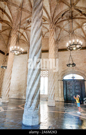 Spain Valencia Ciutat Vella old city historic district Lonja Llotja de la Seda Silk Exchange museum Gothic secular building inside Trading Hall of Columns twisted columns UNESCO World Heritage Site boy smartphone picture Hispanic Spanish Europe EU Eurozone - Stock Photo