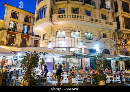 Valencia Spain Hispanic,Ciutat Vella,old city,historic center,Plaza del Mercat,Birra & Blues,restaurant,bar,night evening,al fresco dining,tables,umbr