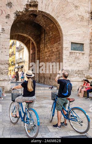 Spain,Valencia,Ciutat Vella,old city,historic district,Torres de Quart,Gothic style defensive towers,city gate,archway,1400s,historical landmark,man,w