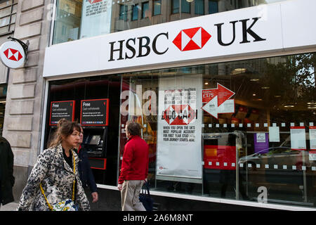 London, UK. 27th Oct, 2019. People walk past HSBC branch in central London. Credit: Dinendra Haria/SOPA Images/ZUMA Wire/Alamy Live News - Stock Photo