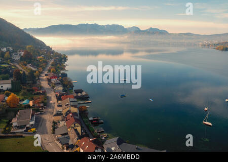 View of Gmunden and the Traunsee from the Grünberg cable car in Gmunden, OÖ, Austria, on a sunny day in autumn - Stock Photo