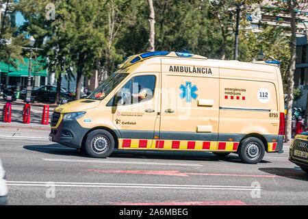 Spain Barcelona Catalonia Catalunya Les Corts Avinguda Diagonal traffic ambulance emergency vehicle Spanish Europe EU Eurozone