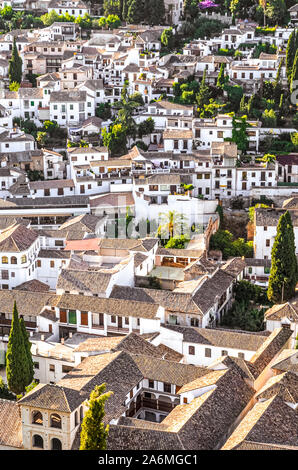 Historic Albaicin district in Granada, Andalusia, Spain photographed from above. Narrow winding streets with traditional houses dating back to medieval Muslim rule over the city. Moorish architecture. - Stock Photo