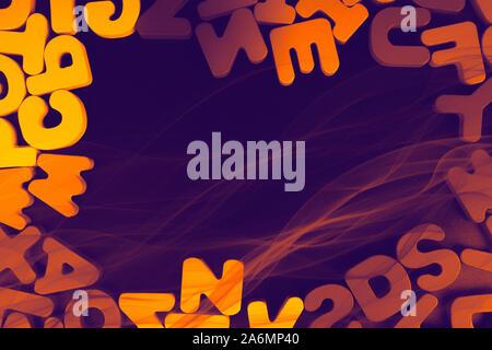Colorful alphabet letter blocks scattered randomly on dark background - Stock Photo