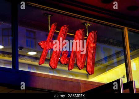 Lit up sign for the fashion retail giant H&M in Regent Street, London, UK - Stock Photo