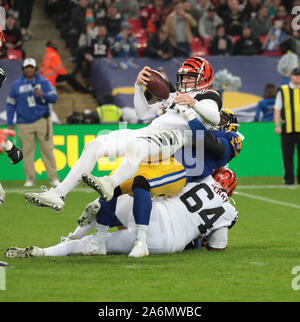 London, UK. 27th Oct, 2019. Cincinnati Bengals Quarter Back Andy Dalton is sacked by the Los Angeles Rams in the NFL London Series in London on Sunday, October 27, 2019. Los Angeles Rams beat the Cincinnati Bengals 24-10. Photo by Hugo Philpott/UPI Credit: UPI/Alamy Live News - Stock Photo