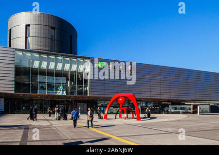 DEC 2, 2018 Hakodate, JAPAN - JR JR Hakodate Station building with tourists at front square under bright sunlight in winter - Stock Photo