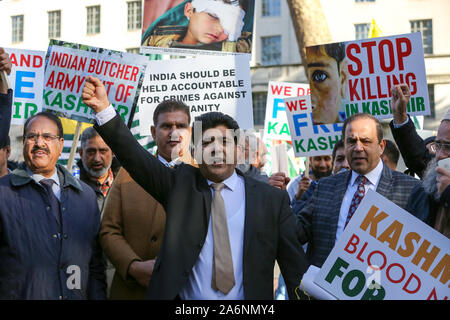 London, UK. 27th Oct, 2019. Kashmir supporters with placards outside Downing Street on Diwali Day.The protest marked an important date for Kashmiris: 27 Oct 1947, the day the Indian army landed in Kashmir. The demonstrators are calling for the international community to stand up against Indian brutality in Kashmir and to protest the abrogation of Article 370. Credit: SOPA Images Limited/Alamy Live News - Stock Photo