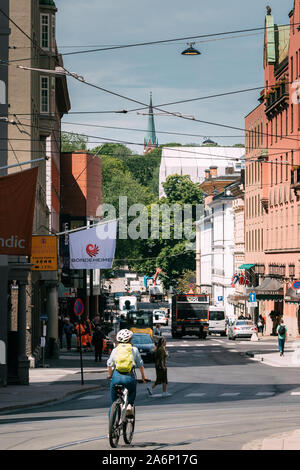 Oslo, Norway - June 24, 2019: Woman Riding On Bicycles in city center. - Stock Photo