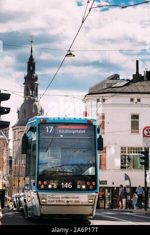 Oslo, Norway - June 24, 2019: Blue Public Tram In Summer Street. - Stock Photo
