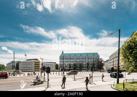 Oslo, Norway - June 24, 2019: People Cross The Road On The Henrik Ibsens gate Street. - Stock Photo