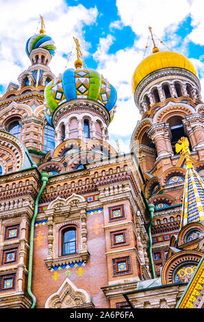 Close up facade of the amazing Church of the Savior on Blood, Saint Petersburg, Russia. Colorful richly decorated building with onion domes. Famous Russian tourist attraction. Orthodox churches. - Stock Photo