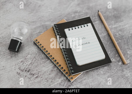 recuirment process goals conceptual still-life, notepads on business desk with Hired vs ignored options - Stock Photo