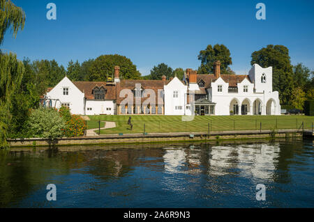 Medmenham Abbey, a private house on the site of a Cistercian Abbey by the Thames between Henley-on-Thames and Marlow under  a clear bright blue sky - Stock Photo