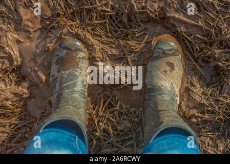 Top View of Muddy Wellington Boots in a Farmer's Field in Scotland - Stock Photo