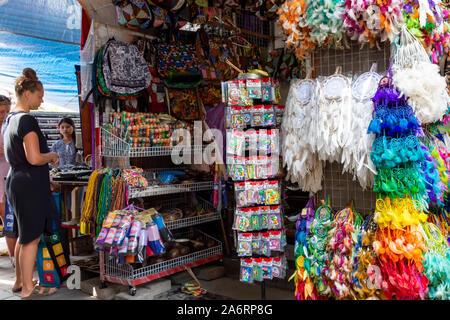 Ubud, Indonesia - September 17, 2018: Scene at Ubud Traditional Art Market, popular souvenir shops in Bali. - Stock Photo