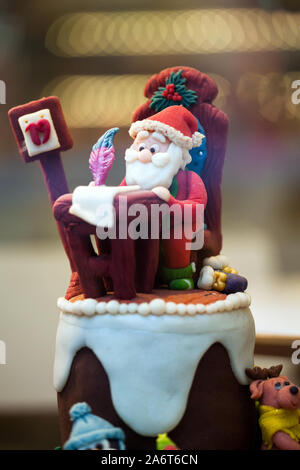Lviv, Ukraine - 17 January 2019: Merry Christmas Cake. Candy store showcase. Santa Claus writing a letter - Stock Photo