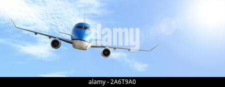 Aerial industry advertisement - generic modern passenger airplane flying above clouds in deep sunlights (copy space). - Stock Photo