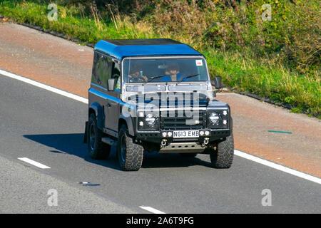 1995 grey Land Rover 90 Defender TDI; UK Vehicular traffic, transport, modern vehicles, saloon cars, south-bound on the 3 lane M6 motorway highway. - Stock Photo