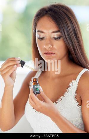 Girl taking CBD Oil - Stock Photo