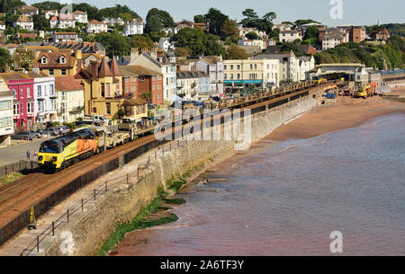An empty Colas Rail Freight cwr train passing through Dawlish top and tailed by Class 70 locomotives Nos 70812 (front) and 70808. - Stock Photo