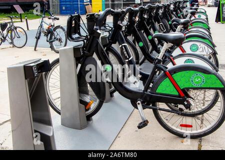 Toronto, Ontario, Canada - SEPTEMBER 27, 2019:  Bike Share Toronto bikes docked at rental station by the CN Tower.