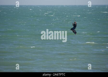A lone Kite surfer working the wind and surf of the English Channel off the Kent coast - Stock Photo