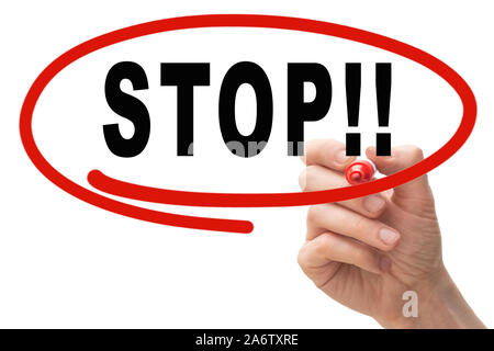 Male hand writing the word STOP on whiteboard with red circle - Stock Photo