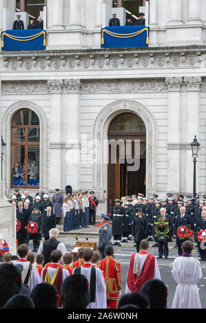 Her Majesty The Queen, The Duke of Edinburgh and The Duchess of Cornwall, along with Princess Alexandra,The Duchess of Cambridge and the Countess of Wessex watch from the balcony as other members of the British Royal family join political leaders and members of the public for Remembrance service at  a wreath laying ceremony at the Cenotaph in Whitehall, London, England. November 2017. - Stock Photo