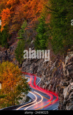 Hawks Nest Route 97- Car trails along the winding route 97 during the autumn foliage season in Sparrow Bush, New York. - Stock Photo