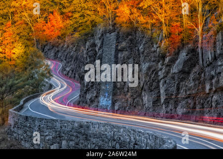 Hawks Nest Road - Car trails along the winding road during autumn in Port Jervis, New York. - Stock Photo