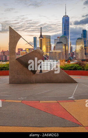 Between 7 and 8 In NYC  - . A sundial sits is in the foreground of the lower New York City during sunset. The golden hues of the sun are reflected in