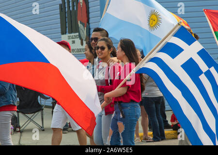 Members of the Multicultural Centre of the Yukon MCY march in the Canada Day Parade held on July 01, 2019 in Whitehorse, Yukon Territory, Canada. - Stock Photo