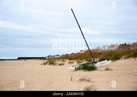 Catamaran on beach at edge of sand dune - Stock Photo