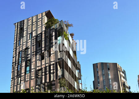 Milan/Italy - October 16, 2019: Residences near Unicredit business centre with curious reflection design on their walls from skyscrapes of Unicredit. - Stock Photo