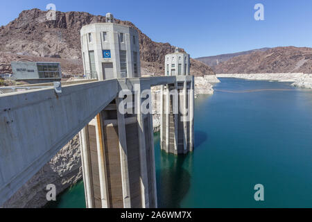 Hoover Dam and the Colorado River and Lake Meed looking northeast on a sunny day with blue sky - Stock Photo