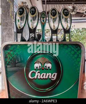 Ko Samui Island, Thailand - March 18, 2019: Closeup of Green bar tap-installation with multiple handles for Chang Beer and its elephants logo. - Stock Photo