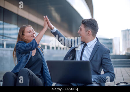 happy young couple looking at laptop screen - Stock Photo