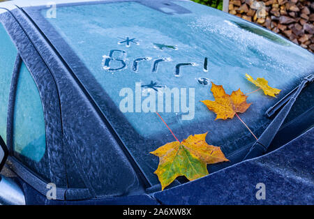 Flintshire, UK. 29th October 2019. UK Weather:  Cold weather and clear skies as temperatures dropped below freezing for many with a cold front heading from the North. Cold and frosty start to the day in the village of Lixwm where a commuter has written the words Brrr in ice on a car windscreen,  Flintshire, Wales.    ©DGDImages/AlamyLiveNews - Stock Photo