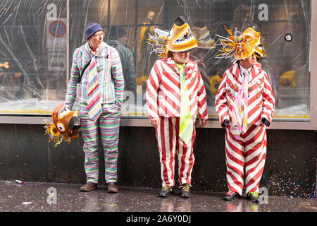 Ruedengasse, Basel, Switzerland - March 13th, 2019. Three carnival participants in funny costumes - Stock Photo