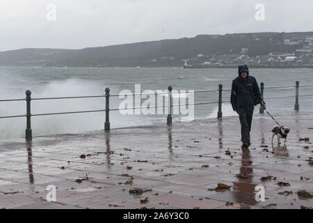 Penzance, Cornwall, UK. 29th October 2019. UK Weather.  Strong wind, big waves and heavy rain batter the sea front at Penzance this morning. Credit Simon Maycock / Alamy Live News. - Stock Photo