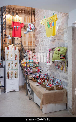 A view inside the door of the Cats of Kotor speciality gift shop in Montenegro's old Town - Stock Photo
