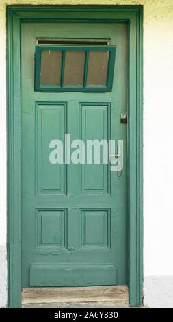 old wooden green door in austria - Stock Photo