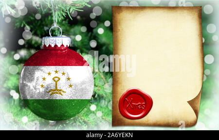 Christmas and New Year background with a flag of Tajikistan. There is a place for your text in the photo - Stock Photo